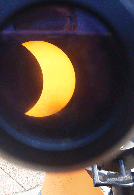 Meicca Miller of Rensselaer Falls caught this photo Monday of the eclipse looking through a telescope at St.Lawrence University.