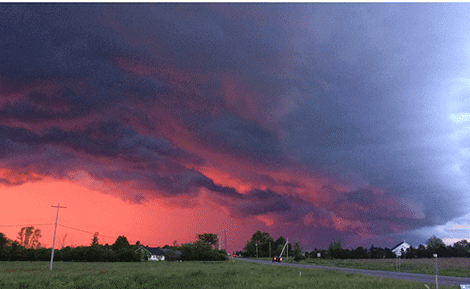 A dark cloud with a red sunset fills the Canton sky. Photo submitted by Joe and Mia Benjamin.