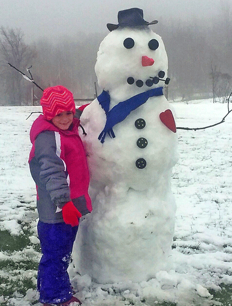 Building her first snowman of the year