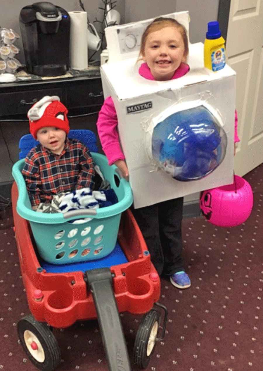 Kaelin and Laken Pryce enjoyed the festivities during Potsdam's Fright Night Thursday. Kaelin was a washing machine and her brother Laken was the basket of laundry. The costumes were made by their parents, Chris and Gina Pryce