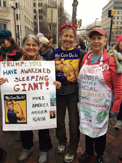 From left, Ginger Storey-Welch, Betsy Kepes, and Marianne Hebert ready for the march.