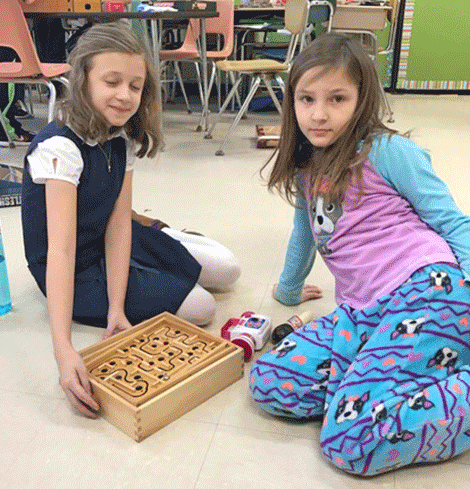 Fourth graders in Angela Regan's class play in the classroom.