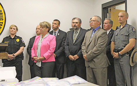 Above is Gouverneur police Chief Laurina Greenhill, Sen. Patty Ritchie and members of the St. Lawrence County Sheriff's Office and New York State Police.