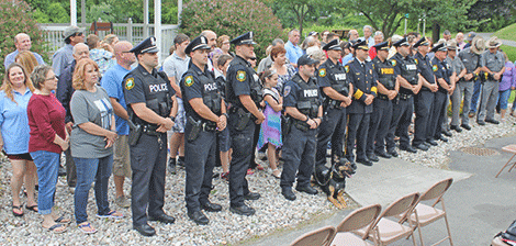At the end of the event, Mayor Tim Currier asked that the residents as a symbolic gesture stand behind the police officers for the shot.