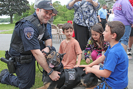 Triplets Wyatt, Wayne and Aubrey White meet Massena police K9 joker and his handler, Ptl. Brandon Huckle.