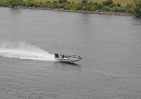 A boater passes by Whittaker Park on the St. Lawrence River. The photo was taken while getting a ride in the air from Adirondack Helicopter Tours, which are offering helicopter rides throughout the events.