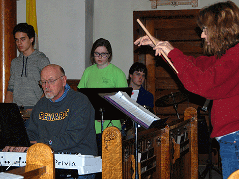 Musicians rehearse at St. Andrew's Church in Norwood for the Dec. 17 performance of 'Joy!'. Above, keyboardist Bill Felix, percussionists Joey LaShomb and Emma French, drummer Joey Marcello and director Chris Paige.