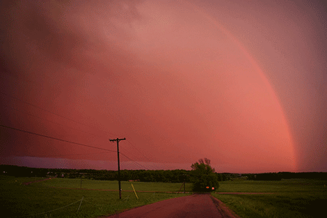 A rainbow appeared after the strange storm Tuesday evening, according to photographer David Zufall of Lisbon. 'The the whole northern sky was a pale red with a dark blood sun  piercing through as lightening flashed above it on the drive from Potsdam to Lisbon Tuesday evening,' he said. 'It felt like driving on a different planet.'