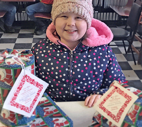 Hannah Burnham, 9, of Madrid gave gifts purchased with her own money for the Potsdam Holiday Fund giving tree.