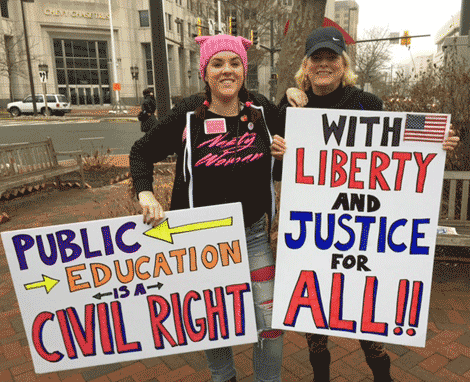 Daughter Kaeley and mother Meg McGovern are ready for the march