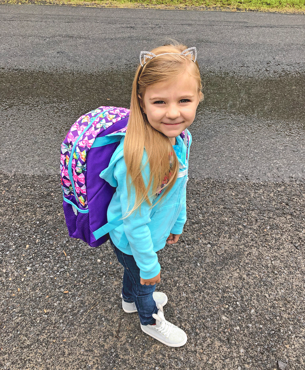 Kaisley Tatro of Norfolk waits for her first bus ride as a kindergartener at Norwood Norfolk Central School. Photo submitted by Hanna Tatro.