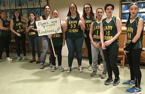NNCS Lady Flyers greeted children with encouraging words