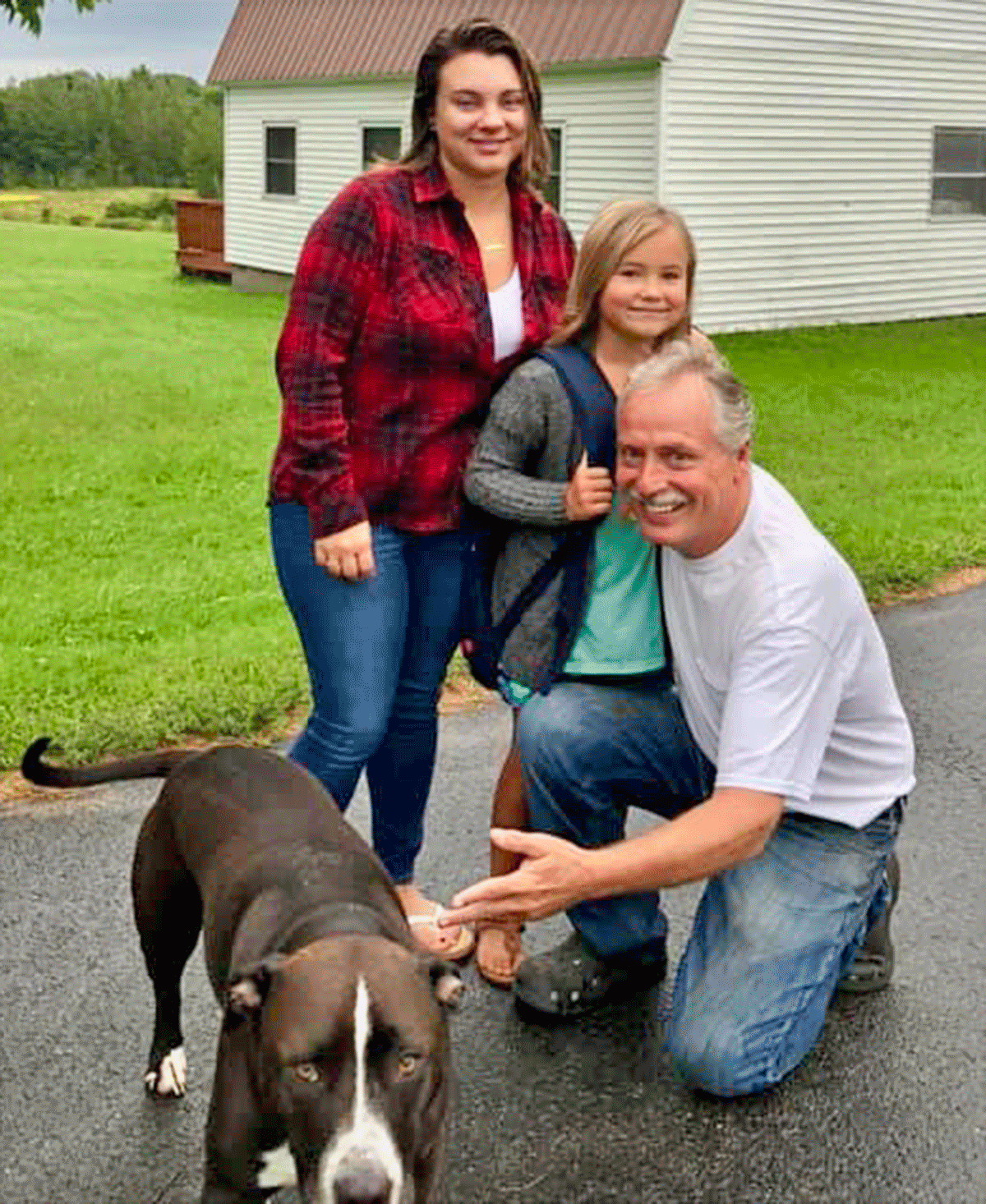Hannah Babcock with her daughter Aubree Phillips and Aubree's Papa, John Clemmo along with the family dog, Remi seeing Aubree off to her first day of second grade at Norwood-Norfolk Central School. Photo taken by Terri Sharlow Clemmo of Norfolk.