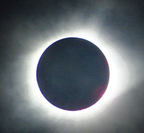 "Photographer Jason Grinstead of Norwood traveled out to Kansas City, Missouri to see the eclipse Monday and spend time with friends. ""For everyone back home who didn't get to see the whole thing, here's a couple pics of the eclipse totality I took today!"" Grinstead said."
