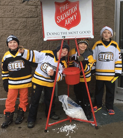 John Friot III, Garritt Palmer, Lorenzo Rand and Avery Zenger bell-ring for the Salvation Army in Ogdensburg..