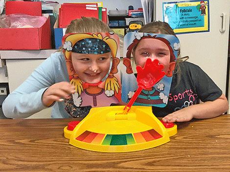 Olivia Plonka and Angelina Favreau play PieFace Showdown in Mrs. Shumway's class..