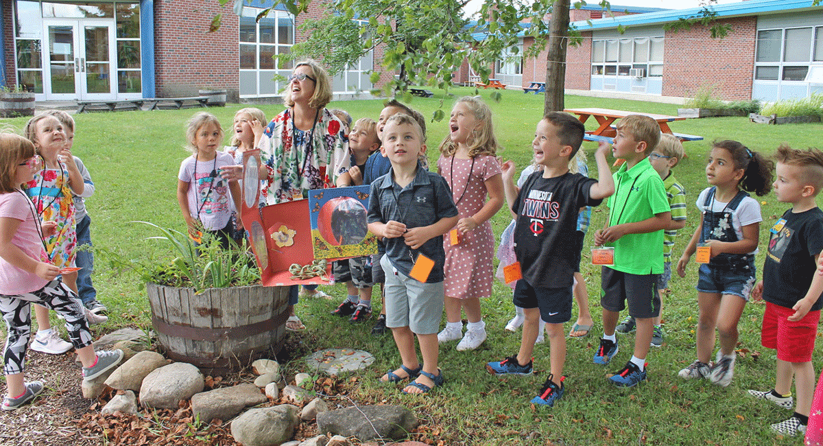 Kindergarten students in Tina Parker's class at Lawrence Avenue Elementary School in Potsdam watch as the monarch butterfly they released began its migration journey. Photo submitted by Potsdam Central.