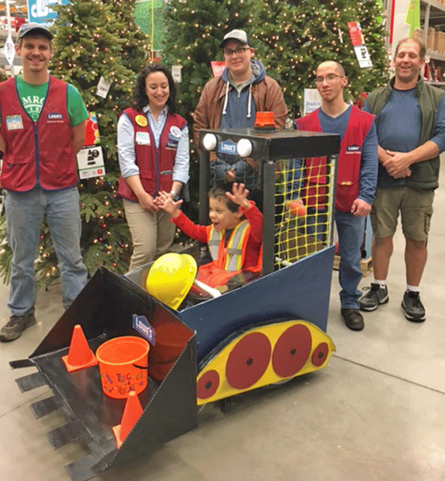 Lowe's employees who joined in creating the bulldozer Halloween costume for Aiden Hernandez, 5, were Ian Pearl, Jasmine Relling, Sebastian Grimm, Zach Eng, Scott Shipman, Cassius Baker, Fred Kellison, Heather Reed, Maeghan Wallace and Becky Moulton. Hernandez uses a wheelchair, which the costume was built around.