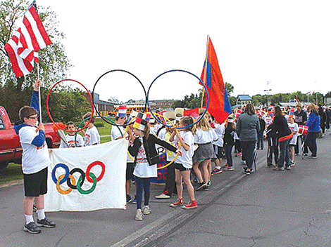 Lawrence Avenue Elementary 4th graders lead the Olympic parade that all students participated in recently.