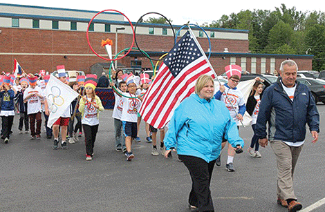 Elementary Principal Jen Gray and Potsdam Mayor Ron Tischler lead the Lawrence Avenue Elementary School's Olympic parade.