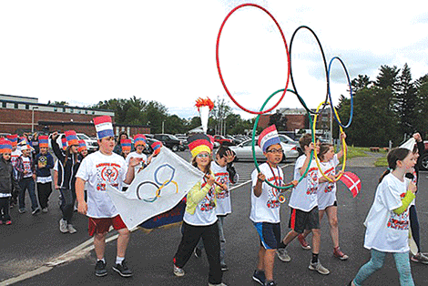 Lawrence Avenue Elementary students carry the Olympics rings at the beginning of the Olympic parade.