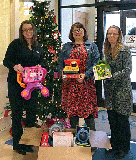 eaComm Federal Credit Union donated toys to the Renewal House. Above, Jessica Zuhlsdorf from Seacomm, Renewal House advocate Alison Wells and Tina Holmes from Seacomm..