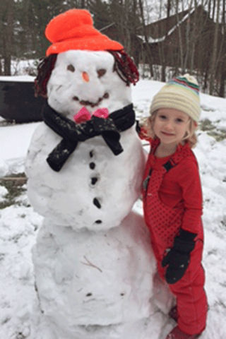 Eloise Howe of Virginia recently visited her grandparents on Trout Lake near Edwards and built her first snowman.