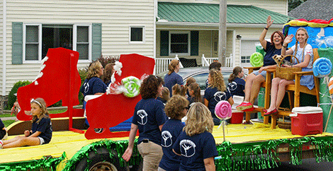 """Many floats and paraders toured the route with a """"Wizard of Oz"""" theme. The Waddington Figure Skating Club even gave Dorothy and Toto a lift."""