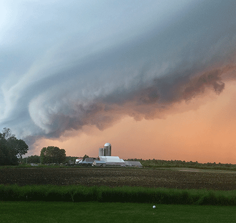 The fast moving storm lingers above a farm in Waddington. Photo by Hidee Griffin.