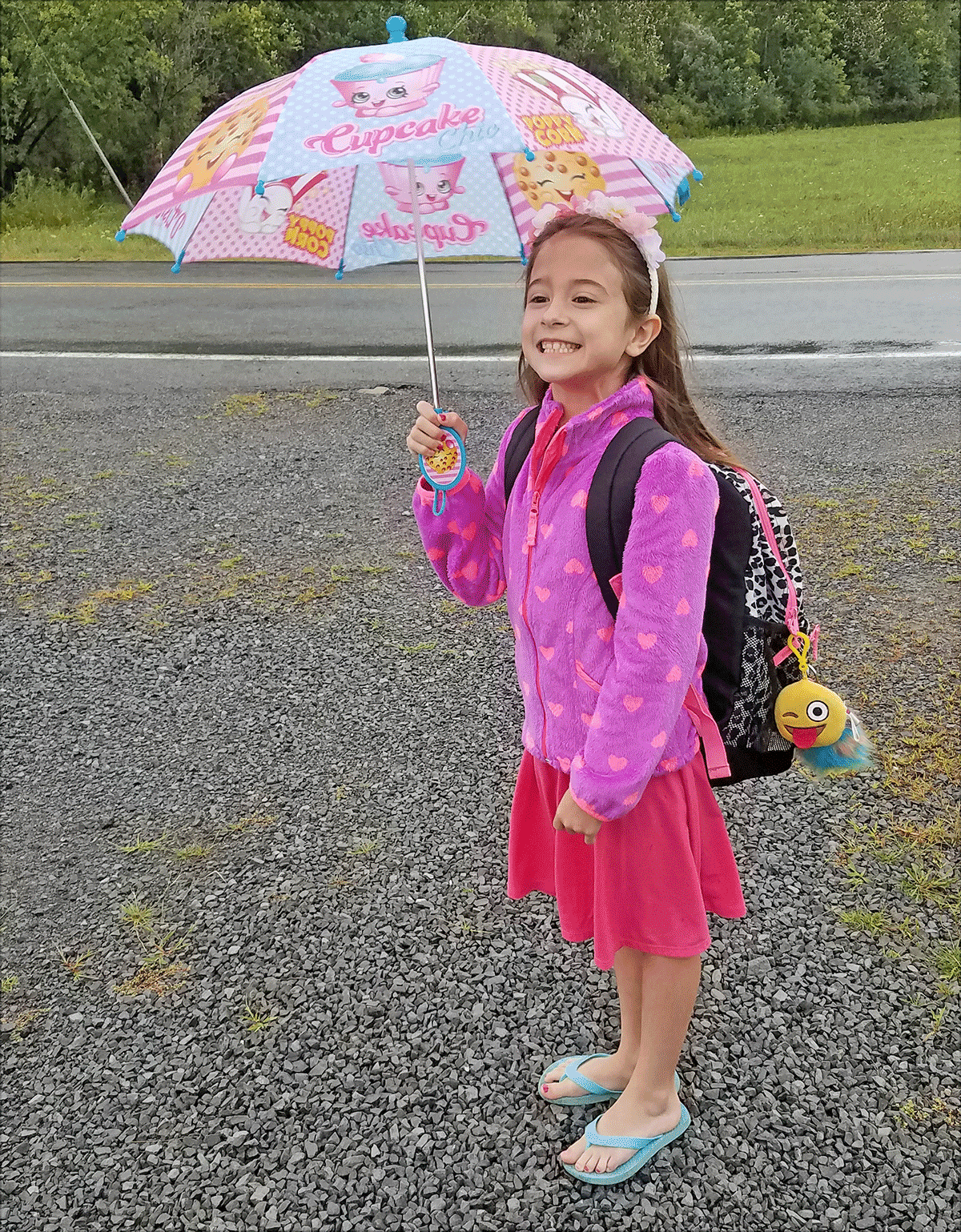 Marah, Winthrop, awaits the bus on the rainy first day of school. Photo submitted by Kayla Fiacco.
