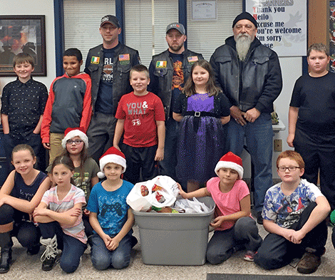 The motorcycle club gave food to the Community Basket Program at St. Lawrence Central school.