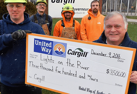 Lights on the River received $3,500 from The Cargill Foundation. From left, Rick Crosier, Frank Davis, Tyler Hitchcock and Chad Gaebel from Cargill and Jeff Buckingham from Lights on the River.