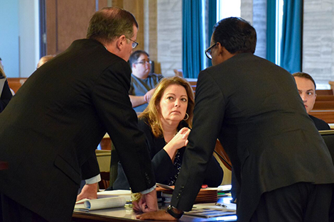 District Attorney Mary Rain confers with special prosecutor William Fitzpatrick, left, and defense attorney Earl Ward on Sept. 20..