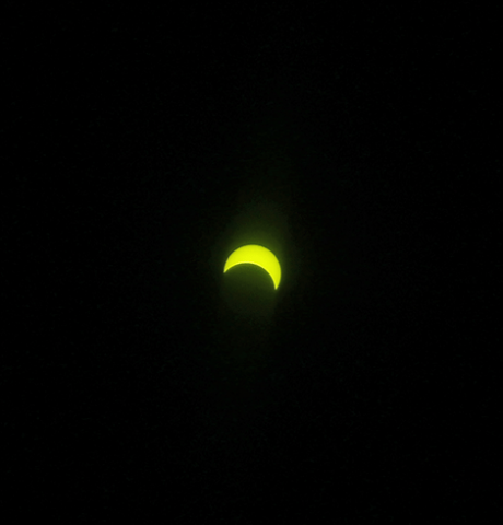 Above is the partial solar eclipse as seen from outside the North Country This Week office in Potsdam at about 2:42 p.m. North Country Now photo by Andy Gardner.