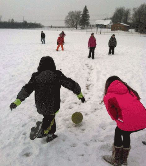Students play kickball in the snow in Kent Fetter's class.
