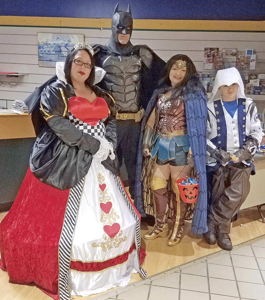 Above at the Mall-O-Ween in Massena are mall manager Erica Leonard as the Queen of Hearts and North Country Crusaders Batman, Wonder Woman and Shadowman.
