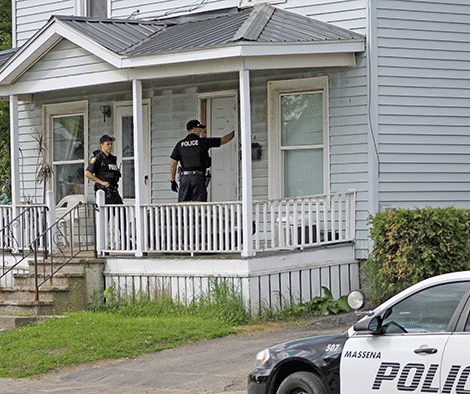Massena patrolmen Connor Truax and Dustin Currier arrive at a North Main Street residence in Massena on Thursday, seeking one of the Operation Gravy Train suspects.