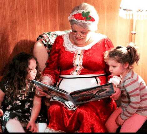 Mrs. Claus recently stopped in Winthrop. She read a Christmas story to and baked cookies with Sabrina Bell and Savannah Gilbert.