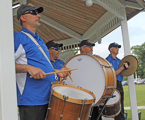 The Norwood Brass Firemen perform in Ives Park on Thursday evening for the Potsdam Rescue Squad's ice cream social.
