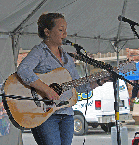Laura Cook sings the classic country song 'Jolene' in the 95.3 The Wolf country showdown competition on Thursday.