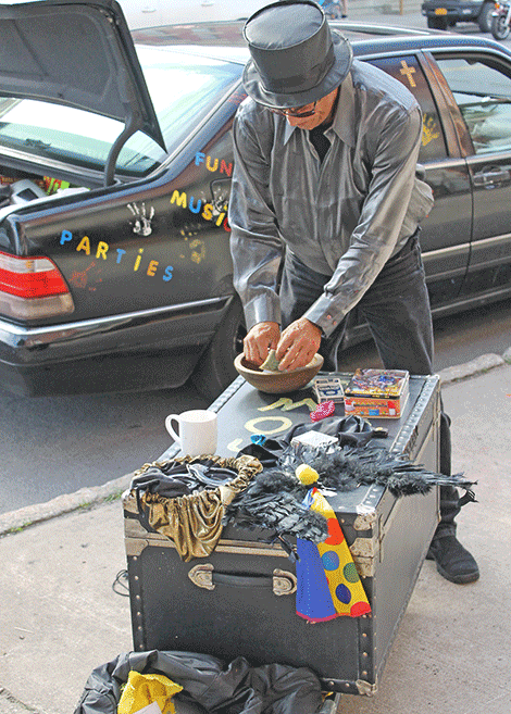 Magician Joey Angel unloads his trunk full of magic gear on Thursday. He plans to perform downtown over the weekend.