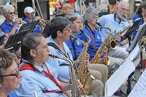 The New Horizons Swing Band performs in downtown Potsdam on Thursday.