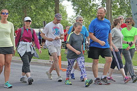 The walker leg of the Tour de Potsdam departs from the starting line on Waverly Street on Thursday.
