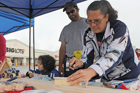 Autumn Baxter, right, and Kristy Baxter build toys at the Lowe's 'Build and Grow Kids Clinic' at Outer Market Mania on Friday.