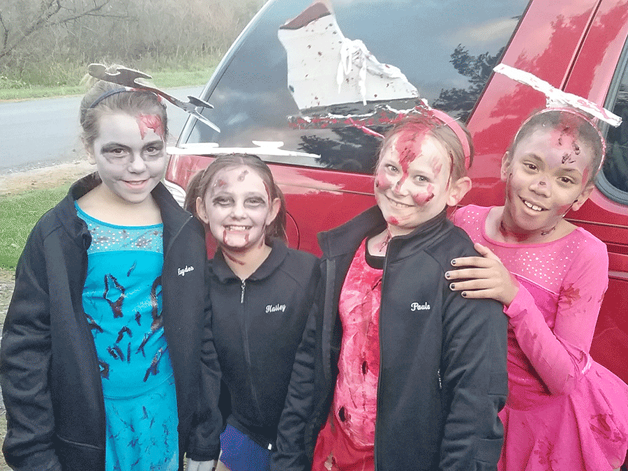 Potsdam figure skaters Hayden Spoor, Hailey Richards and Paula Sherman and friend Jasmine Mcnight dressed up as zombie figure skaters. Photo submitted by Stacey Sprague.