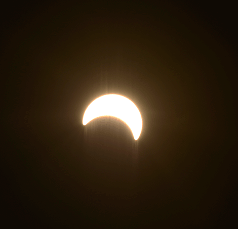 Above is Monday's partial solar eclipse as seen from Pierrepont around peak viewing time. Photo submitted by Dennis Barr.