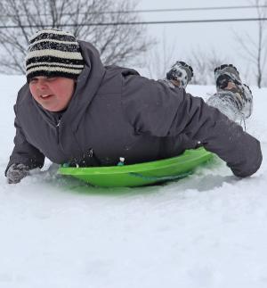 Oburg-sledding-boy-on-belly-best.png