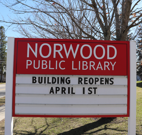 Norwood-Library-sign-reopening-April-1.png