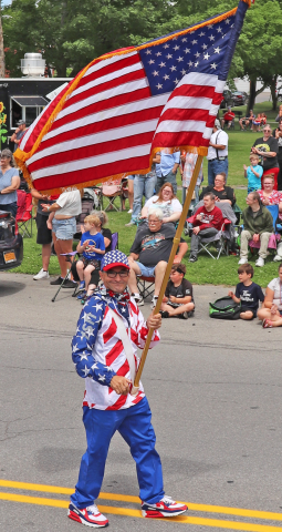 Norwood-parade-man-with-flag.png