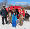 Black-Lake-ice-fishing-Dylan-Smith,-Kaelynn-Bice-in-front-holding-crappies.png